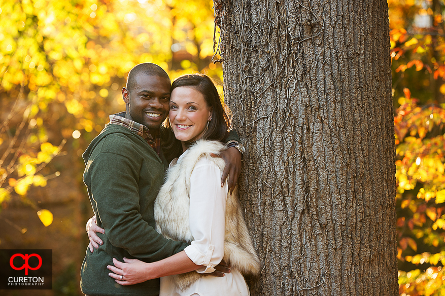 Couple in awesome fall leaves during their downtown Greenville SC engagement session..