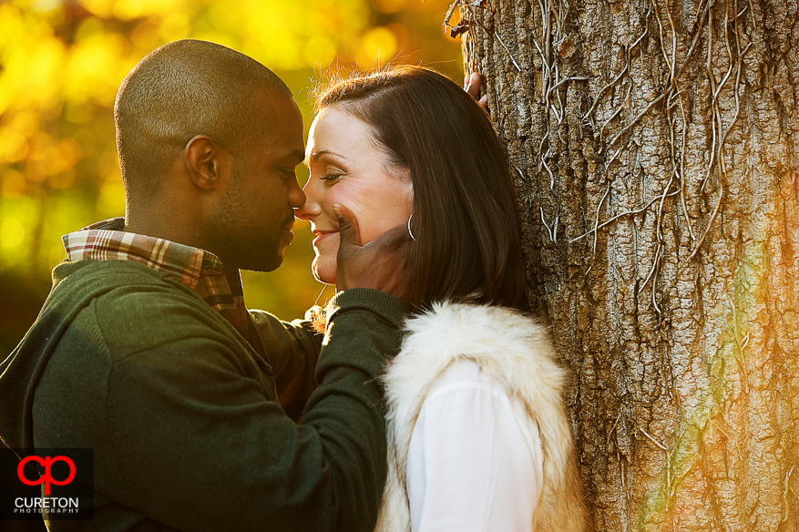 Couple kissing in Falls Park during their downtown Greenville SC engagement session..