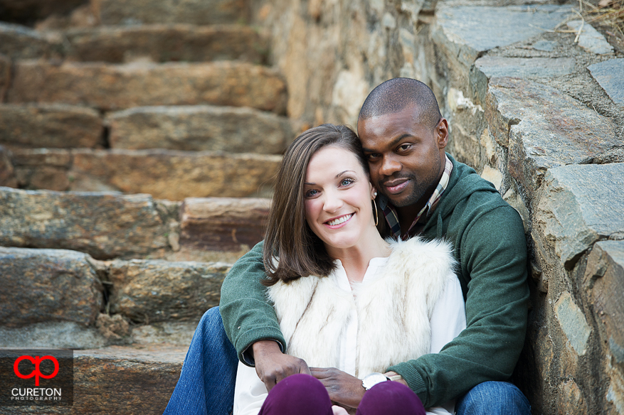 Couple on the steps at Falls Park during their downtown Greenville SC engagement session.