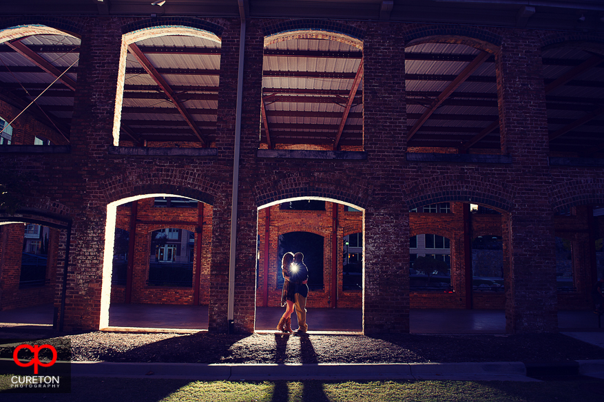 Creative engagement photo of a couple at the Wyche pavilion in downtown Greenville SC.