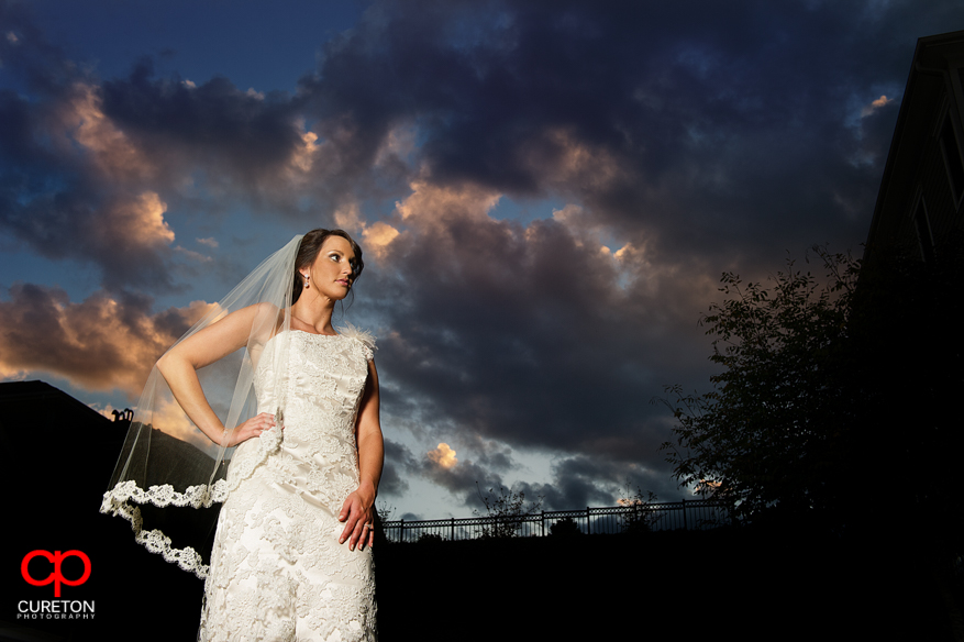 Bride with gorgeous Greenville sunset in the background.