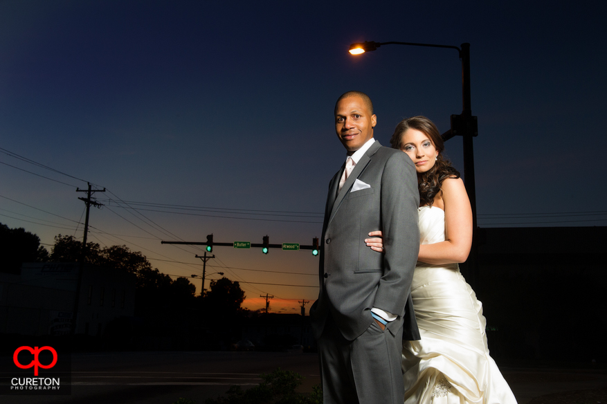 Sunset photo of a bride and groom after their wedding at the Upcountry History Museum in downtown Greenville,SC.