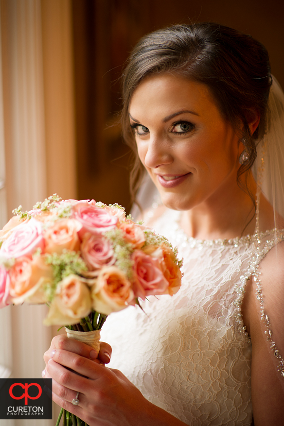 Bride holding her flowers at the Duncan Estate in Spartanburg,SC.
