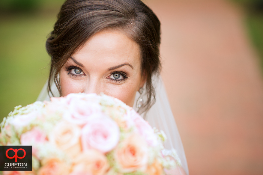 Bride looking over her flowers at the Duncan Estate in Spartanburg,SC..