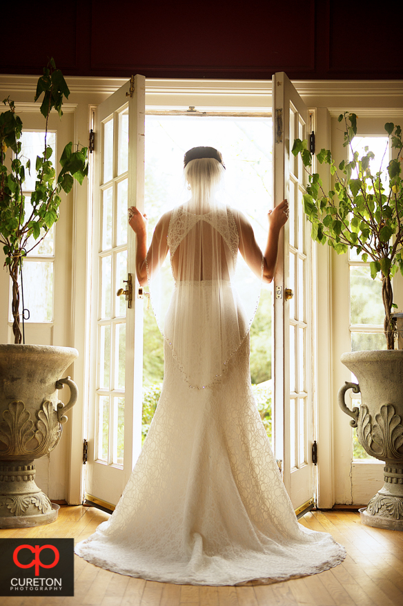 Bride looking out the double doors during a recent Duncan Estate bridal session.