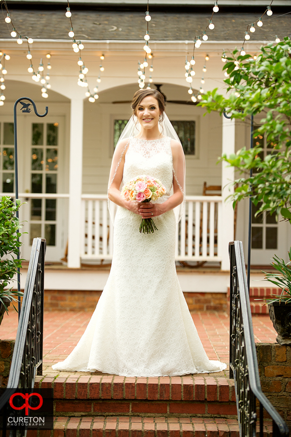 Bride outside on the patio during a recent Duncan Estate bridal session.