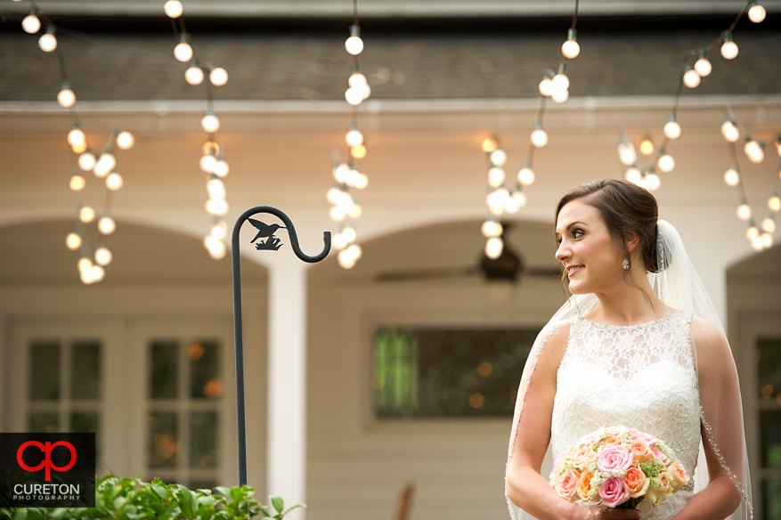 Bride on te patio at the Duncan Estate.