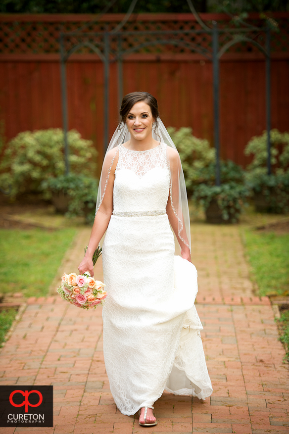 Bride walking in her dress.