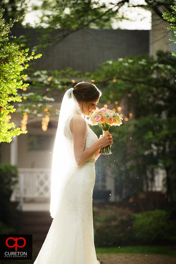 Bride smelling her flowers during a recent Duncan Estate Bridal Session in Spartanburg, SC.
