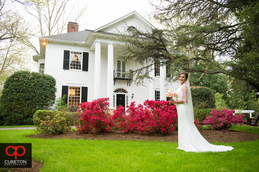 Bride in front of the Duncan Estate.