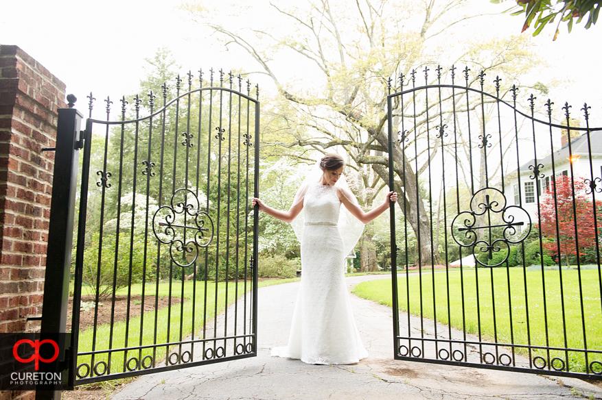Bride holding onto a gate during a recent Duncan Estate bridal session..