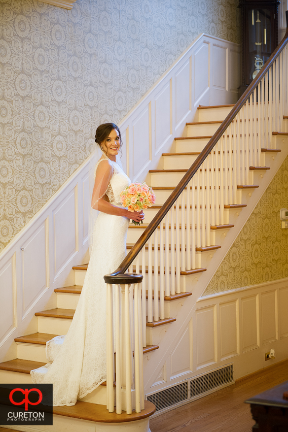 Bride on the stairs at the Duncan Estate.
