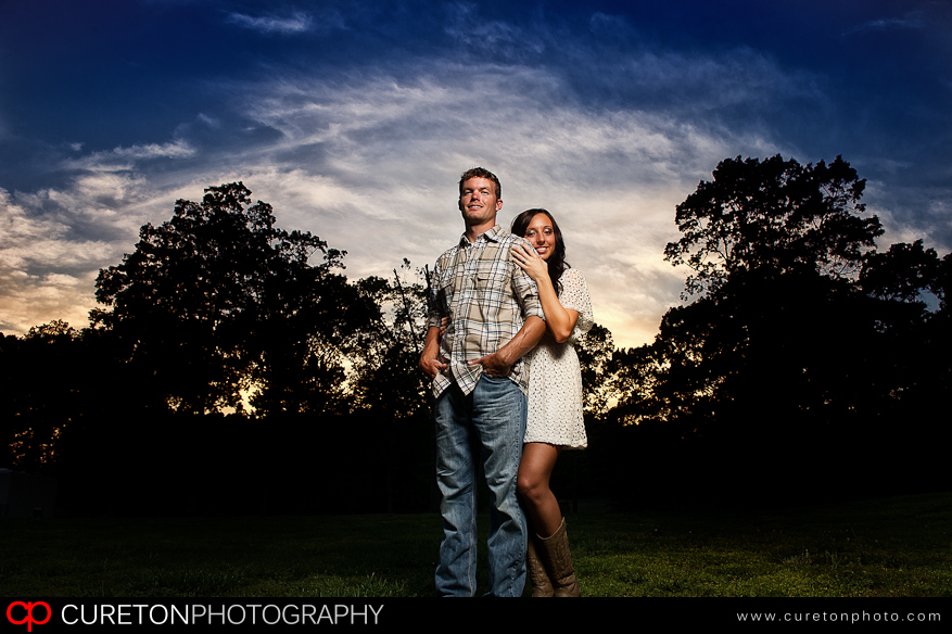 Epic sky and a couple posing at sunset.