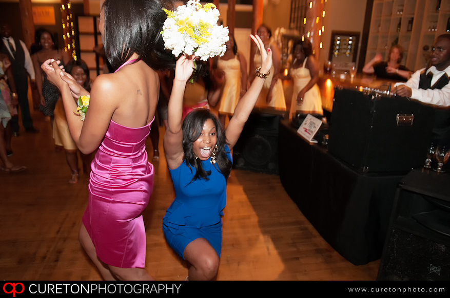 Girl catching bouquet at Simpsonville wedding reception.