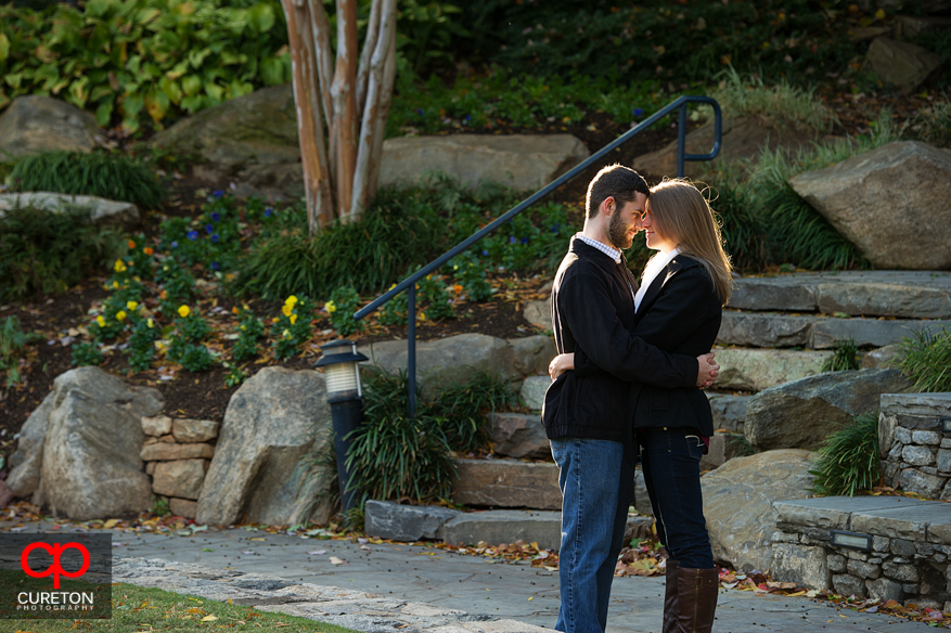 A couple standing at the top of Falls Park in Greenville,SC during their engagement session.