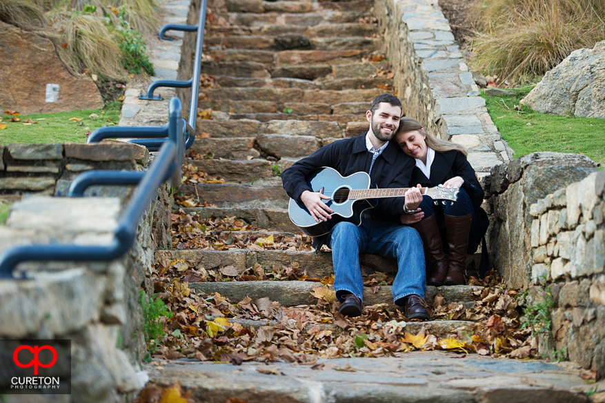 A man plays guitar for his fiancee in Falls Park in downtown Greenville,SC.