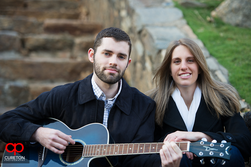 A couple with a guitar in Falls Park.