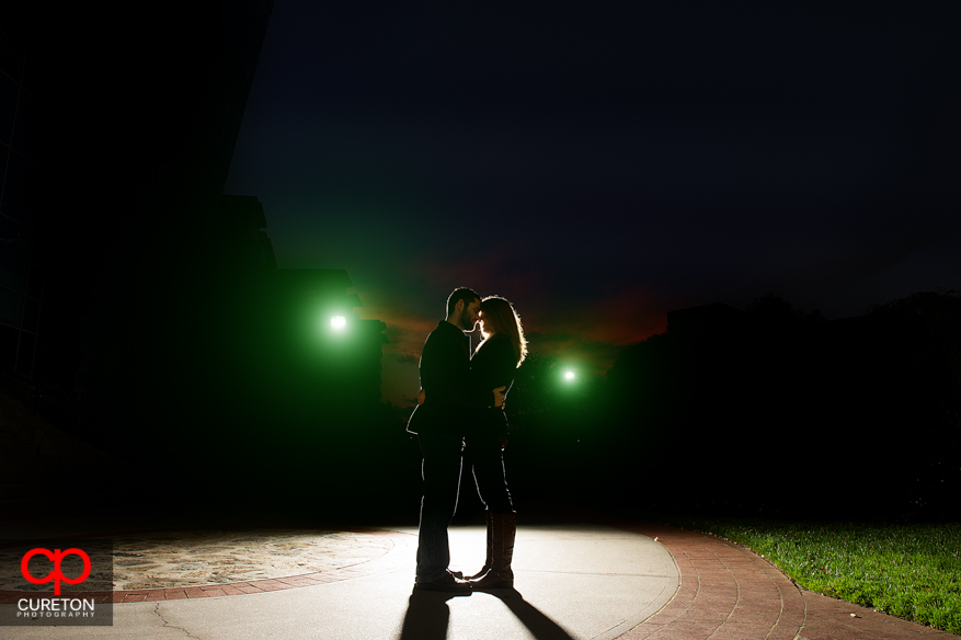 Silhouette of a couple in Falls Park during their engagement session.