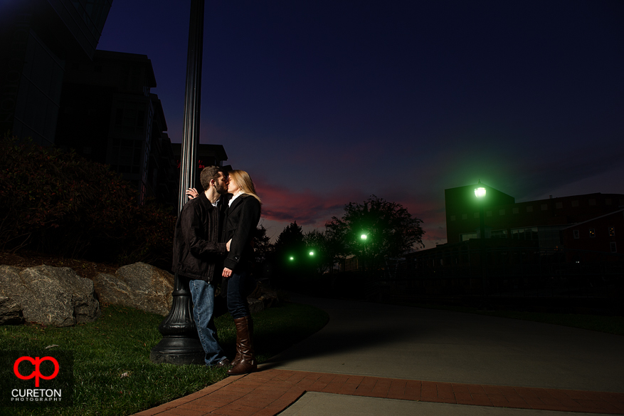 Couple standing near the Reedy River during a recent engagement session.