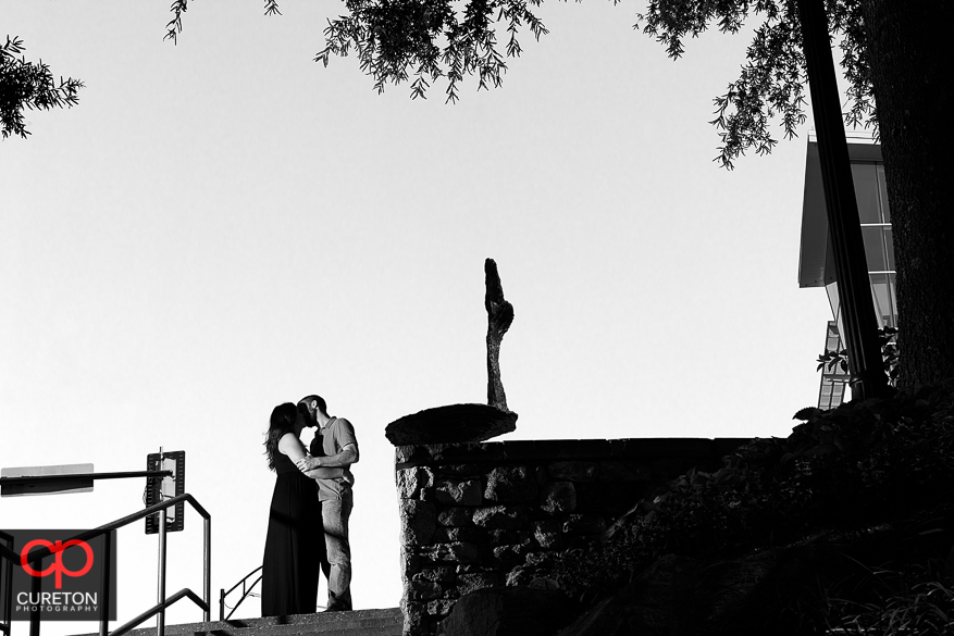 Couple kissing at the top of Falls Park.