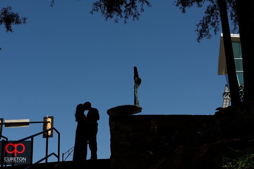 Silhouette of an engaged couple in Falls Park in downtown Greenville,SC.
