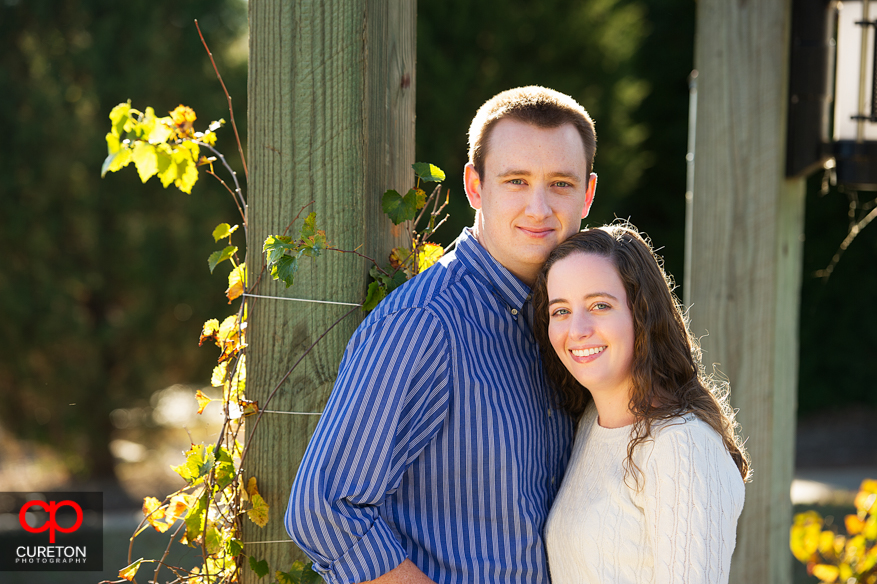 Couple looking at the camera during their Furman University engagement session.