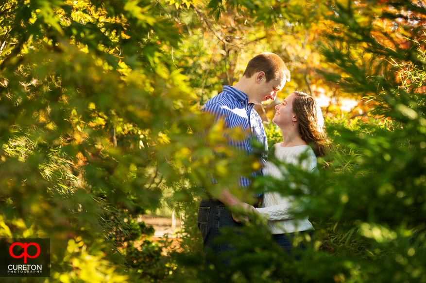 Couple on the walking oath at Furman University during an engagement session.