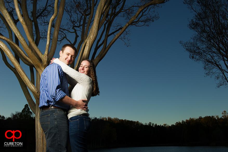 Couple posing by the lake at Furman.