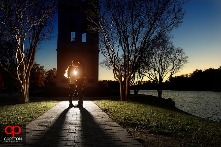 Sunset engagement photo by the lake at Furman University.