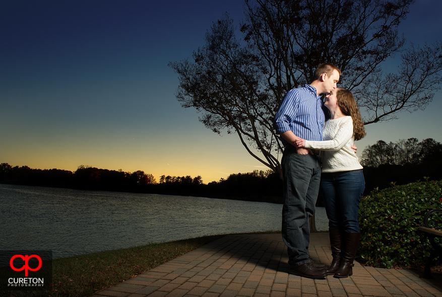 Couple kissing at sunset at Furman.