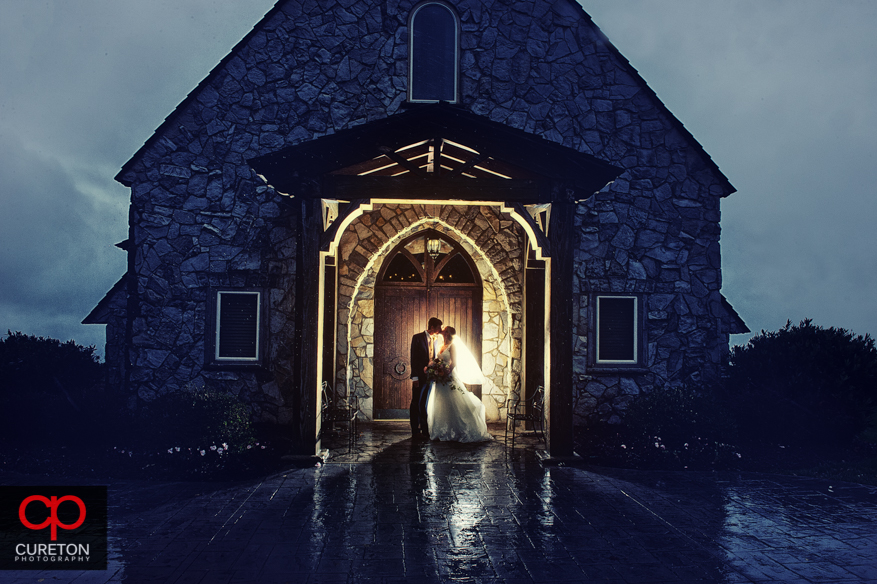 Bride and groom in the rain after their Glassy Chapel wedding.