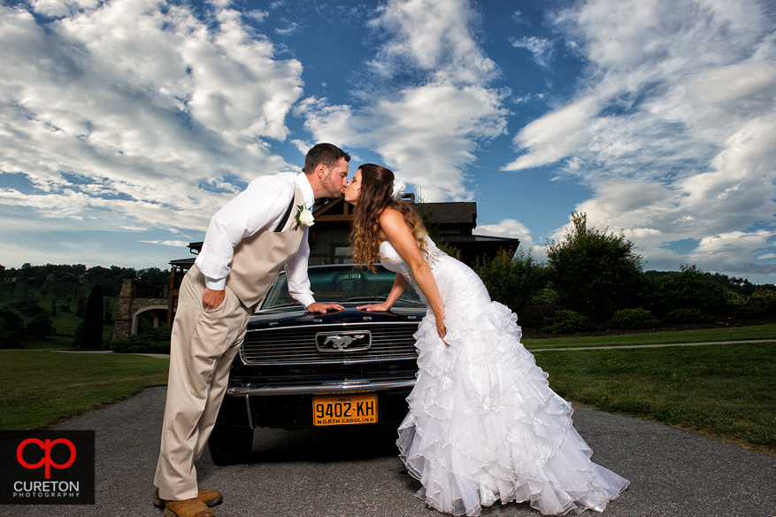 Bride and Groom after their wedding at Grand Highlands with a vintage Mustang.