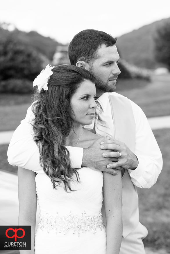 Very fashion looking black and white of married couple.