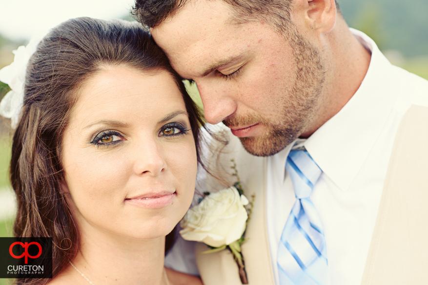 Closeup of bride and groom.