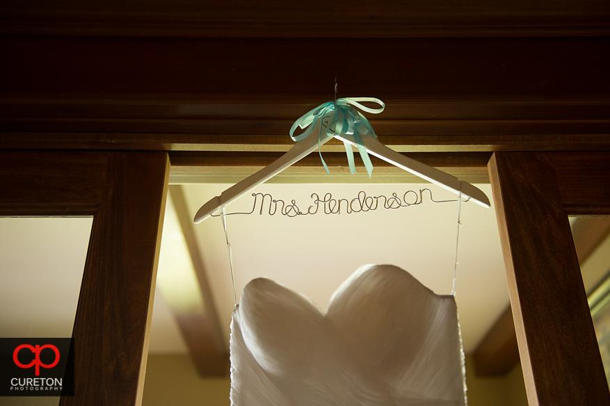 The brides custom dress hanger.