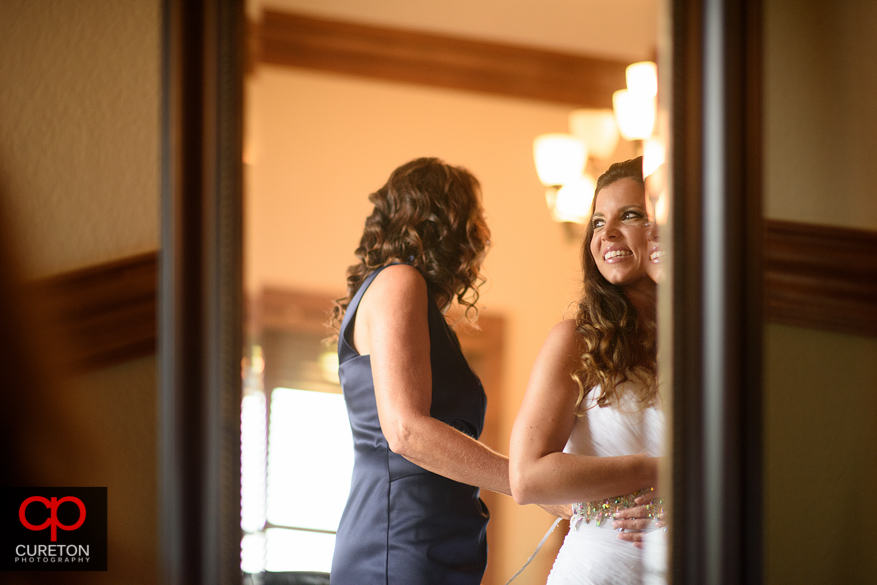 Bride in a mirror as she is getting ready.