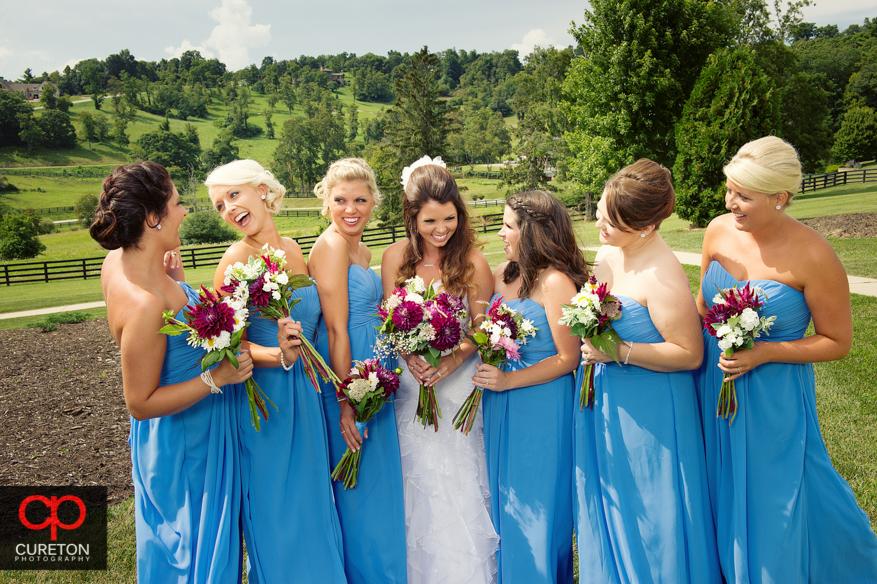 Candid shot of bridesmaids laughing.