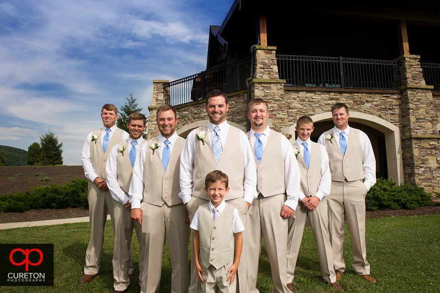 Groomsmen in front of the lodge.