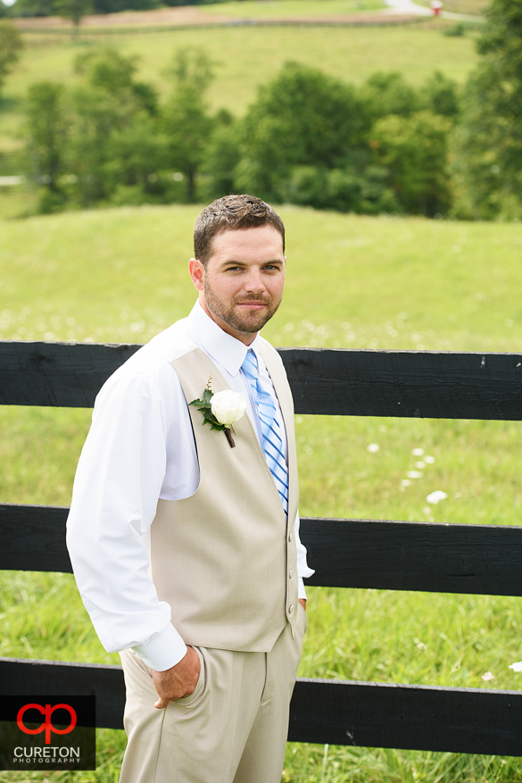 The groom outside the lodge.