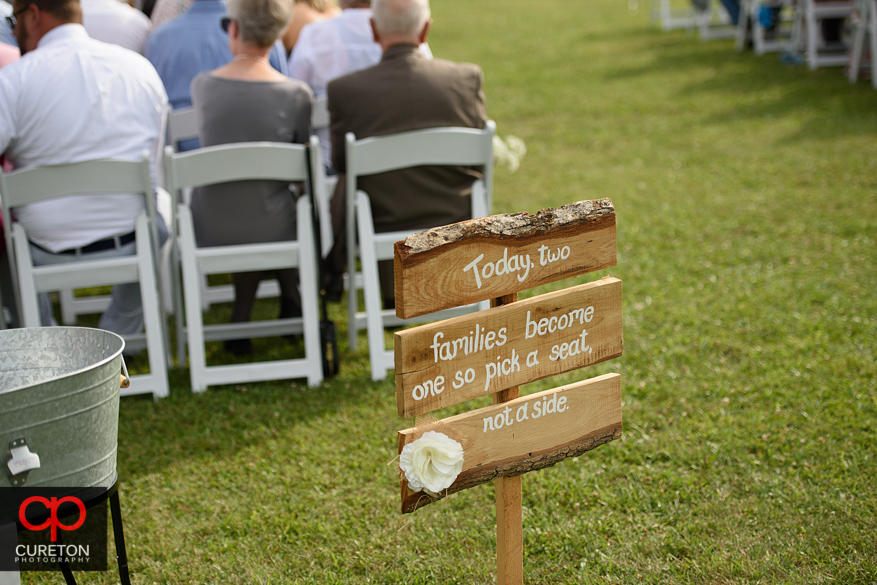 Wedding signs in the field.