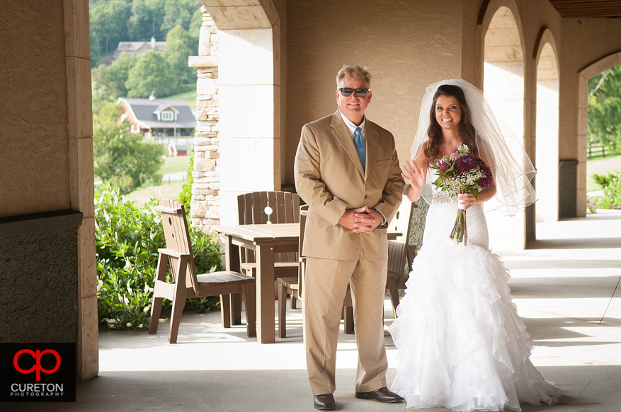 The bride and her father waiting to walk down the aisle.