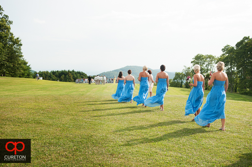 The bridesmaids walking to the aisle.
