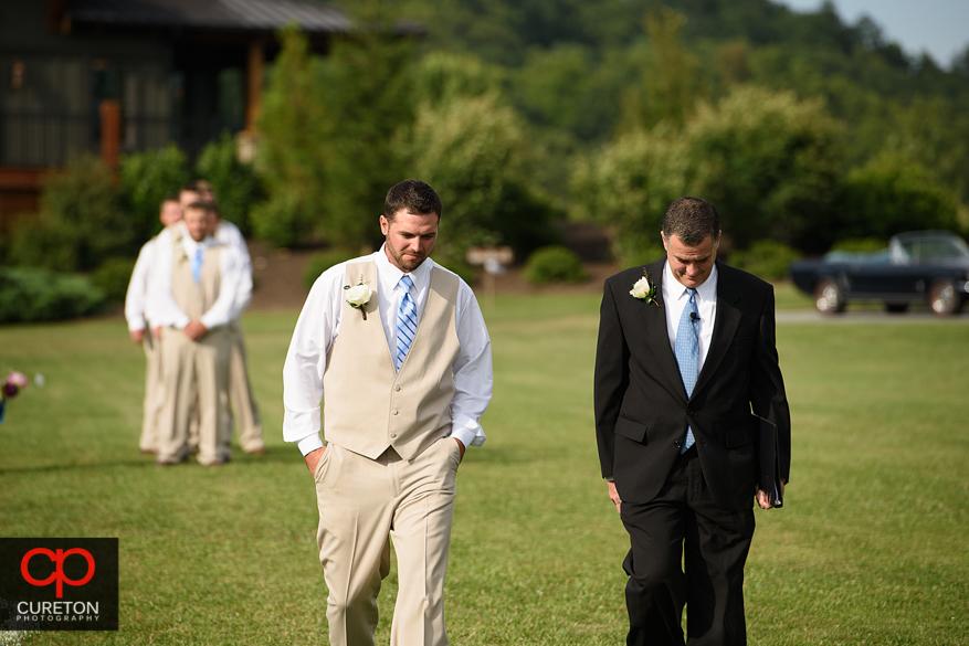 The groom walking down the aisle.