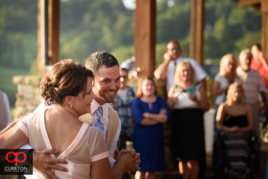 The groom dances with his mother.