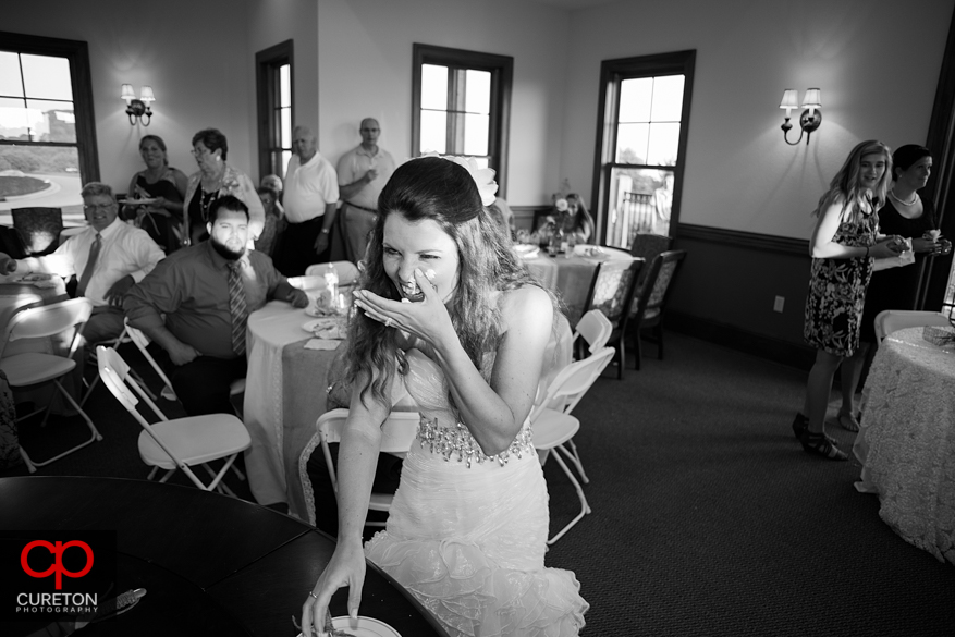 Bride with cake on her face.