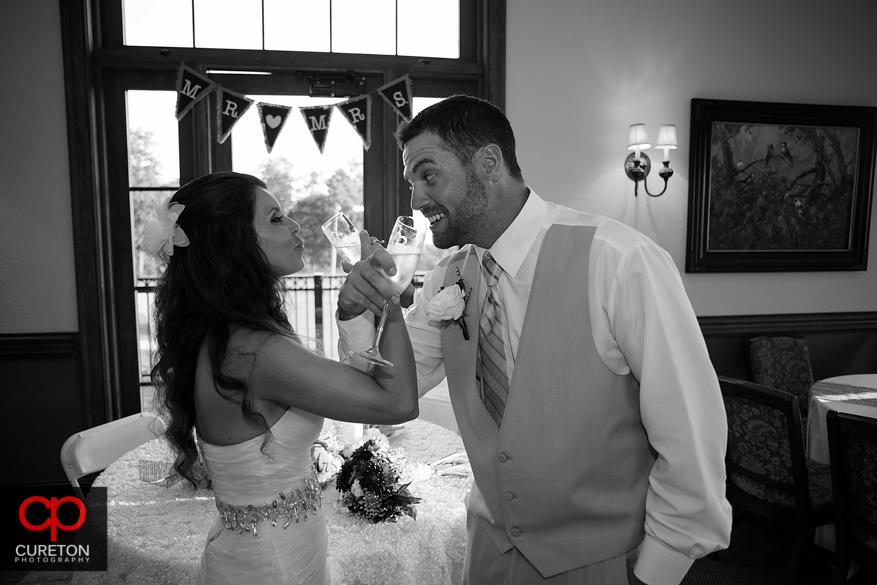 Bride and groom share a toast.