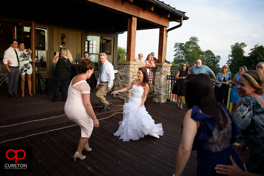 Guests dancing at the Grand Highlands at the Bearwallow Mountain wedding reception.