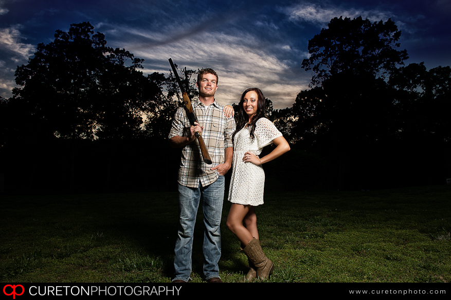 Great creative engagement session with the groom to be holding a shotgun.