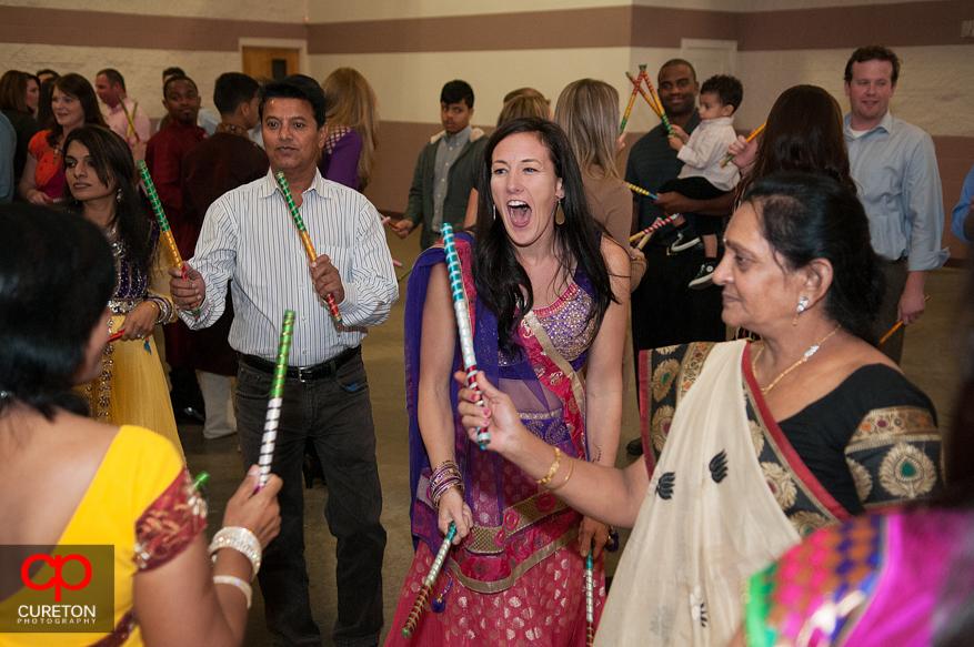 Brides family with Dandiya sticks.