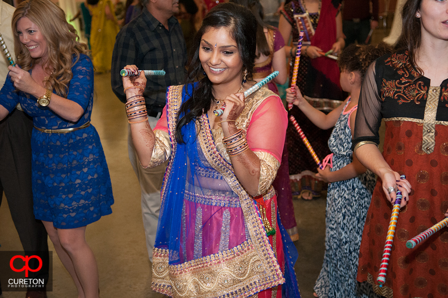 Indian bride with Dandiya sticks.